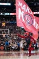 Dec 1, 2013; Toronto, Ontario, CAN; The Toronto Raptors mascot carries a flag onto the court during a time out in the fourth quarter of a game against the Denver Nuggets at the Air Canada Centre. Denver won the game 112-98. Mandatory Credit: Mark Konezny-USA TODAY Sports