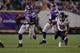 Dec 1, 2013; Minneapolis, MN, USA; Minnesota Vikings running back Adrian Peterson (28) rushes away from Chicago Bears cornerback Tim Jennings (26) in overtime at Mall of America Field at H.H.H. Metrodome. Vikings win 23-20 in overtime. Mandatory Credit: Bruce Kluckhohn-USA TODAY Sports