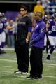 Dec 1, 2013; Minneapolis, MN, USA; Minnesota Vikings quarterback Josh Freeman (12) and quarterback coach Craig Johnson (right) watch drills before the game with the Chicago Bears at Mall of America Field at H.H.H. Metrodome. Vikings win 23-20 in overtime. Mandatory Credit: Bruce Kluckhohn-USA TODAY Sports