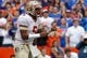 Nov 30, 2013; Gainesville, FL, USA; Florida State Seminoles quarterback Jameis Winston (5) calls a play and points against the Florida Gators during the second quarter at Ben Hill Griffin Stadium. Mandatory Credit: Kim Klement-USA TODAY Sports