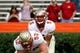 Nov 30, 2013; Gainesville, FL, USA; Florida State Seminoles offensive linesman Bryan Stork (52) hikes the ball to quarterback Jameis Winston (5) prior to the game against the Florida Gators at Ben Hill Griffin Stadium. Mandatory Credit: Kim Klement-USA TODAY Sports
