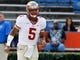 Nov 30, 2013; Gainesville, FL, USA; Florida State Seminoles quarterback Jameis Winston (5) runs out onto the field before he works out prior to the game against the Florida Gators at Ben Hill Griffin Stadium. Mandatory Credit: Kim Klement-USA TODAY Sports