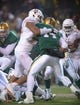 Dec 7, 2013; Waco, TX, USA; Texas Longhorns defensive end Jackson Jeffcoat (44) sacks Baylor Bears quarterback Bryce Petty (14) during the game at Floyd Casey Stadium. The Baylor Bears defeated the Texas Longhorns 30-10 to win the Big 12 championship. Mandatory Credit: Jerome Miron-USA TODAY Sports