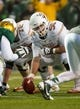 Dec 7, 2013; Waco, TX, USA; Texas Longhorns center Dominic Espinosa (55) during the game against the Baylor Bears at Floyd Casey Stadium. The Baylor Bears defeated the Texas Longhorns 30-10 to win the Big 12 championship. Mandatory Credit: Jerome Miron-USA TODAY Sports