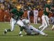 Dec 7, 2013; Waco, TX, USA; Baylor Bears running back Glasco Martin (8) eludes Texas Longhorns linebacker Peter Jinkens (19) during the game at Floyd Casey Stadium. The Baylor Bears defeated the Texas Longhorns 30-10 to win the Big 12 championship. Mandatory Credit: Jerome Miron-USA TODAY Sports