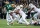 Dec 7, 2013; Waco, TX, USA; Texas Longhorns defensive end Cedric Reed (88) tackles Baylor Bears quarterback Bryce Petty (14) during the game at Floyd Casey Stadium. The Baylor Bears defeated the Texas Longhorns 30-10 to win the Big 12 championship. Mandatory Credit: Jerome Miron-USA TODAY Sports