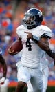 Nov 23, 2013; Gainesville, FL, USA; Georgia Southern Eagles quarterback Kevin Ellison (4) runs the ball in for a touchdown during the second quarter against the Florida Gators at Ben Hill Griffin Stadium. Mandatory Credit: Kim Klement-USA TODAY Sports