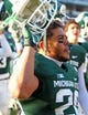 Nov 30, 2013; East Lansing, MI, USA; Michigan State Spartans running back Nick Hill (20)  celebrates win after a game against the Minnesota Golden Gophers at Spartan Stadium. Mandatory Credit: Mike Carter-USA TODAY Sports