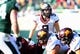 Nov 30, 2013; East Lansing, MI, USA; Minnesota Golden Gophers quarterback Philip Nelson (9) changes play against the Michigan State Spartans during the 1st half a game at Spartan Stadium. Mandatory Credit: Mike Carter-USA TODAY Sports