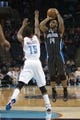 Dec 11, 2013; Charlotte, NC, USA; Orlando Magic point guard Jameer Nelson (14) shoots the ball over Charlotte Bobcats point guard Kemba Walker (15) during the first half at Time Warner Cable Arena. Mandatory Credit: Jeremy Brevard-USA TODAY Sports