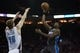 Dec 11, 2013; Charlotte, NC, USA; Orlando Magic point guard E'Twaun Moore (55) shoots the ball over Charlotte Bobcats center Cody Zeller (40) during the first half at Time Warner Cable Arena. Mandatory Credit: Jeremy Brevard-USA TODAY Sports
