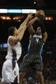 Dec 11, 2013; Charlotte, NC, USA; Orlando Magic shooting guard Arron Afflalo (4) shoots the ball over Charlotte Bobcats shooting guard Jeff Taylor (44) during the first half at Time Warner Cable Arena. Mandatory Credit: Jeremy Brevard-USA TODAY Sports