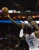 Dec 11, 2013; Charlotte, NC, USA; Orlando Magic shooting guard Victor Oladipo (5) shoots the ball over Charlotte Bobcats power forward Jeff Adrien (4) during the first half at Time Warner Cable Arena. Mandatory Credit: Jeremy Brevard-USA TODAY Sports