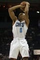 Dec 11, 2013; Charlotte, NC, USA; Charlotte Bobcats shooting guard Gerald Henderson (9) shoots the ball during the second half against the Orlando Magic at Time Warner Cable Arena. The Magic defeated the Bobcats 92-83. Mandatory Credit: Jeremy Brevard-USA TODAY Sports