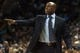 Dec 11, 2013; Charlotte, NC, USA; Orlando Magic head coach Jacque Vaughn calls out to his players during the second half against the Charlotte Bobcats at Time Warner Cable Arena. The Magic defeated the Bobcats 92-83. Mandatory Credit: Jeremy Brevard-USA TODAY Sports