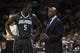 Dec 11, 2013; Charlotte, NC, USA; Orlando Magic head coach Jacque Vaughn talks with shooting guard Victor Oladipo (5) during the second half against the Charlotte Bobcats at Time Warner Cable Arena. The Magic defeated the Bobcats 92-83. Mandatory Credit: Jeremy Brevard-USA TODAY Sports