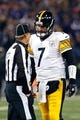 Nov 28, 2013; Baltimore, MD, USA; Pittsburgh Steelers quarterback Ben Roethlisberger (7) talks with line judge Ron Marinucci (107) during the game against the Baltimore Ravens on Thanksgiving at M&T Bank Stadium. Mandatory Credit: Mitch Stringer-USA TODAY Sports