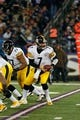 Nov 28, 2013; Baltimore, MD, USA; Pittsburgh Steelers quarterback Ben Roethlisberger (7) turns to make a hand off against the Baltimore Ravens during a NFL football game on Thanksgiving at M&T Bank Stadium. Mandatory Credit: Mitch Stringer-USA TODAY Sports