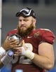 Dec 7, 2013; Charlotte, NC, USA; Florida State Seminoles offensive linesman Bryan Stork (52) holds the ACC Championship trophy. The Seminoles defeated the Blue Devils 45-7 at Bank of America Stadium. Mandatory Credit: Bob Donnan-USA TODAY Sports