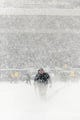 Dec 8, 2013; Philadelphia, PA, USA; A Philadelphia Eagles grounds crew worker clears snow off the lines during the first quarter against the Detroit Lions at Lincoln Financial Field. The Eagles defeated the Lions 34-20. Mandatory Credit: Howard Smith-USA TODAY Sports