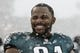 Dec 8, 2013; Philadelphia, PA, USA; Philadelphia Eagles defensive end Fletcher Cox (91) along the sidelines prior to playing the Detroit Lions at Lincoln Financial Field. The Eagles defeated the Lions 34-20. Mandatory Credit: Howard Smith-USA TODAY Sports