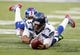 Dec 15, 2013; East Rutherford, NJ, USA;  Seattle Seahawks quarterback Russell Wilson (3) dives forward for a first down as New York Giants cornerback Terrell Thomas (24) catches him from behind during the first half at MetLife Stadium. Mandatory Credit: Jim O'Connor-USA TODAY Sports