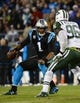 Dec 15, 2013; Charlotte, NC, USA; Carolina Panthers quarterback Cam Newton (1) with the ball as New York Jets defensive end Muhammad Wilkerson (96) pressures in the third quarter at Bank of America Stadium. Mandatory Credit: Bob Donnan-USA TODAY Sports