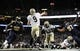 Dec 15, 2013; St. Louis, MO, USA; New Orleans Saints quarterback Drew Brees (9) passes as St. Louis Rams defensive tackle Michael Brockers (90) and defensive end Eugene Sims (97) defend during the second half at the Edward Jones Dome. The Rams defeated the Saints 27-16. Mandatory Credit: Jeff Curry-USA TODAY Sports