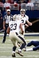 Dec 15, 2013; St. Louis, MO, USA;  New Orleans Saints quarterback Drew Brees (9) throws a pass to running back Pierre Thomas (23) during a game against the St. Louis Rams at the Edward Jones Dome. Mandatory Credit: Scott Kane-USA TODAY Sports