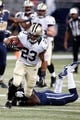 Dec 15, 2013; St. Louis, MO, USA;  New Orleans Saints running back Pierre Thomas (23) carries the ball in the first half  against the St. Louis Rams at the Edward Jones Dome. Mandatory Credit: Scott Kane-USA TODAY Sports