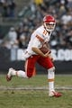 Dec 15, 2013; Oakland, CA, USA; Kansas City Chiefs quarterback Alex Smith (11) runs the ball against the Oakland Raiders in the fourth quarter at O.co Coliseum. The Chiefs defeated the Raiders 56-31. Mandatory Credit: Cary Edmondson-USA TODAY Sports