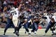 Dec 15, 2013; St. Louis, MO, USA;  New Orleans Saints defensive end Akiem Hicks (76) attempts to block a pass thrown by St. Louis Rams quarterback Kellen Clemens (10) at the Edward Jones Dome. Mandatory Credit: Scott Kane-USA TODAY Sports