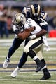 Dec 15, 2013; St. Louis, MO, USA;  St. Louis Rams defensive end William Hayes (95) tackles New Orleans Saints running back Mark Ingram (22) during the second half at the Edward Jones Dome. Mandatory Credit: Scott Kane-USA TODAY Sports