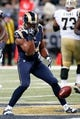 Dec 15, 2013; St. Louis, MO, USA; St. Louis Rams defensive end Robert Quinn (94) celebrates after recovering a fumble against the New Orleans Saints at the Edward Jones Dome. Mandatory Credit: Scott Kane-USA TODAY Sports