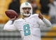 Dec 8, 2013; Pittsburgh, PA, USA; Miami Dolphins quarterback Matt Moore (8) throws on the field before playing the Pittsburgh Steelers at Heinz Field. The Dolphins won 34-28. Mandatory Credit: Charles LeClaire-USA TODAY Sports