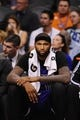 Nov 20, 2013; Phoenix, AZ, USA; Sacramento Kings center DeMarcus Cousins (15) reacts on the bench against the Phoenix Suns in the second half at US Airways Center. The Kings defeated the Suns 113-106. Mandatory Credit: Jennifer Stewart-USA TODAY Sports