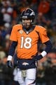 November 17, 2013; Denver, CO, USA; Denver Broncos quarterback Peyton Manning (18) warms up before the game against the Kansas City Chiefs at Sports Authority Field at Mile High. The Broncos defeated the Chiefs 27-17. Mandatory Credit: Kyle Terada-USA TODAY Sports