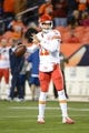 November 17, 2013; Denver, CO, USA; Kansas City Chiefs quarterback Alex Smith (11) warms up before the game against the Denver Broncos at Sports Authority Field at Mile High. The Broncos defeated the Chiefs 27-17. Mandatory Credit: Kyle Terada-USA TODAY Sports