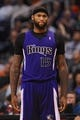 Nov 20, 2013; Phoenix, AZ, USA; Sacramento Kings center DeMarcus Cousins (15) reacts on the court against the Phoenix Suns in the second half at US Airways Center. The Kings defeated the Suns 113-106. Mandatory Credit: Jennifer Stewart-USA TODAY Sports