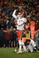 November 17, 2013; Denver, CO, USA; Kansas City Chiefs quarterback Alex Smith (11) passes the football during the fourth quarter against the Denver Broncos at Sports Authority Field at Mile High. The Broncos defeated the Chiefs 27-17. Mandatory Credit: Kyle Terada-USA TODAY Sports