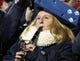 Nov 30, 2013; Madison, WI, USA; A Penn State Nittany Lions band member performs with her blue cheesehead during the game with the Wisconsin Badgers at Camp Randall Stadium. Penn State defeated Wisconsin 31-24. Mandatory Credit: Mary Langenfeld-USA TODAY Sports