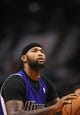 Nov 20, 2013; Phoenix, AZ, USA; Sacramento Kings center DeMarcus Cousins (15) shoots a free throw in the first half against the Phoenix Suns at US Airways Center. The Kings defeated the Suns 113-106. Mandatory Credit: Jennifer Stewart-USA TODAY Sports