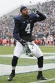 Nov 23, 2013; University Park, PA, USA; Penn State Nittany Lions safety Adrian Amos (4) gestures prior to the game against the Nebraska Cornhuskers at Beaver Stadium. Nebraska defeated Penn State 23-20 in overtime. Mandatory Credit: Matthew O'Haren-USA TODAY Sports