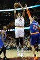 Dec 10, 2013; Cleveland, OH, USA; Cleveland Cavaliers center Andrew Bynum (21) shoots over New York Knicks power forward Andrea Bargnani (77) at Quicken Loans Arena. Cleveland won 109-94. Mandatory Credit: David Richard-USA TODAY Sports