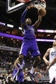 Dec 17, 2013; Charlotte, NC, USA; Sacramento Kings forward center Jason Thompson (34) dunks during the first half of the game against the Charlotte Bobcats at Time Warner Cable Arena. Mandatory Credit: Sam Sharpe-USA TODAY Sports