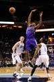 Dec 17, 2013; Charlotte, NC, USA; Sacramento Kings forward Travis Outlaw (25) loses the ball as he is defended by Charlotte Bobcats guard Ben Gordon (8) and forward Cody Zeller (40) during the first half of the game at Time Warner Cable Arena. Mandatory Credit: Sam Sharpe-USA TODAY Sports