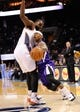 Dec 17, 2013; Charlotte, NC, USA; Sacramento Kings guard Isaiah Thomas (22) drives into Charlotte Bobcats center Al Jefferson (25) during the first half of the game at Time Warner Cable Arena. Mandatory Credit: Sam Sharpe-USA TODAY Sports