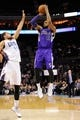 Dec 17, 2013; Charlotte, NC, USA; Sacramento Kings forward Derrick Williams (13) shoots as he is defended by Charlotte Bobcats forward Jeffery Taylor (44) during the first half of the game at Time Warner Cable Arena. Mandatory Credit: Sam Sharpe-USA TODAY Sports