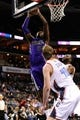 Dec 17, 2013; Charlotte, NC, USA; Sacramento Kings forward center Jason Thompson (34) drives to the basket as he is defended by Charlotte Bobcats forward Cody Zeller (40) during the first half of the game at Time Warner Cable Arena. Mandatory Credit: Sam Sharpe-USA TODAY Sports