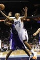Dec 17, 2013; Charlotte, NC, USA; Charlotte Bobcats guard Ramon Sessions (7) drives past Sacramento Kings forward Travis Outlaw (25) during the second half of the game at Time Warner Cable Arena. Bobcats win 95-87. Mandatory Credit: Sam Sharpe-USA TODAY Sports
